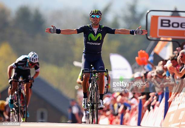 Alejandro Valverde of Spain and Movistar Team celebrates as he crosses the finish line to win the 79th La Fleche Wallonne from Waremme to Huy on...