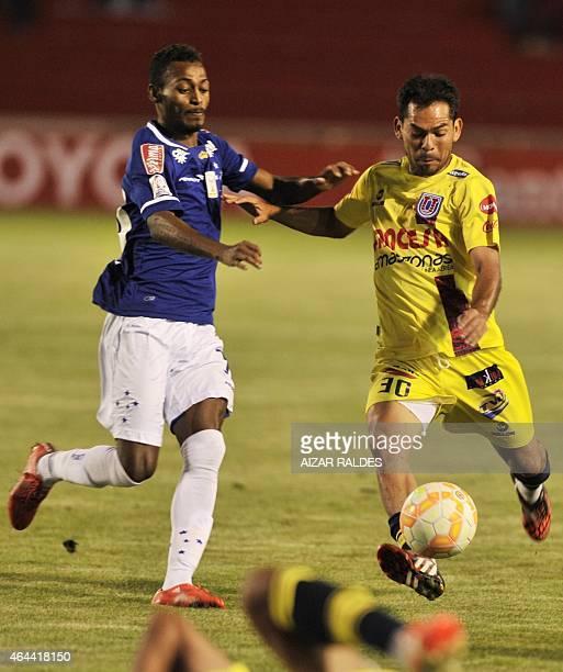Alejandro Vejarano of Bolivian Universitario de Sucre and Marquinhos of Brazil Cruzeiro vie for the ball during their Libertadores Cup football match...