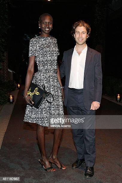 Alek Wek and Cameron Lamb attend Jeff Koons A Retrospective at The Whitney Museum of American Art on June 24 2014 in New York City