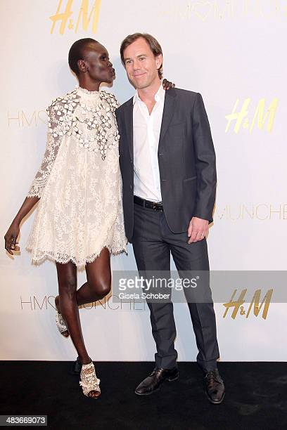 Alek Wek and CEO of HM KarlJohan Persson attend the HM store opening on April 9 2014 in Munich Germany