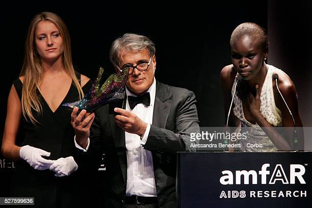 Alek Wek and Cesare Paciotti attend the Amfar Aids Research gala and auction in Milan