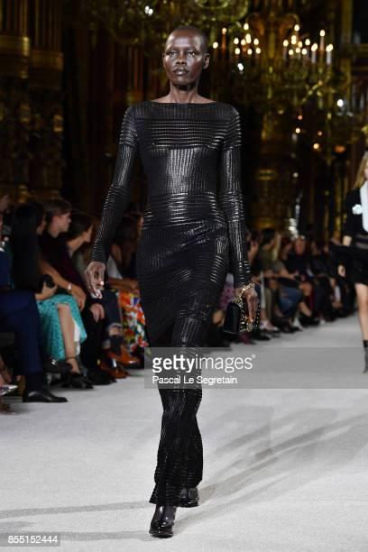 Alek Wek walks the runway during the Balmain show as part of the Paris Fashion Week Womenswear Spring/Summer 2018 on September 28 2017 in Paris France