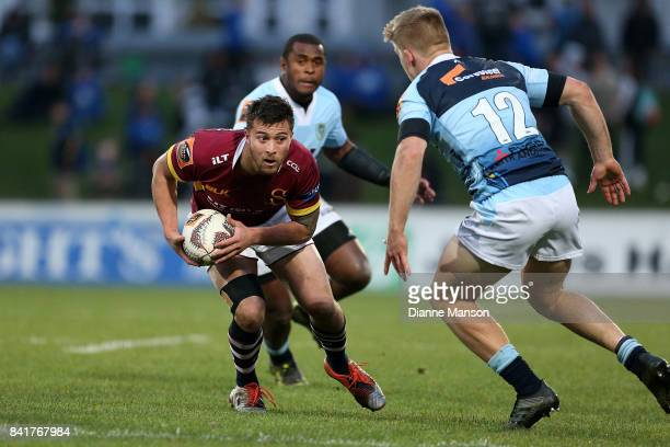 Aleki Morris of Southland fends off Jack Goodhue of Northland during the round three Mitre 10 Cup match between Southland and Northland at Rugby Park...
