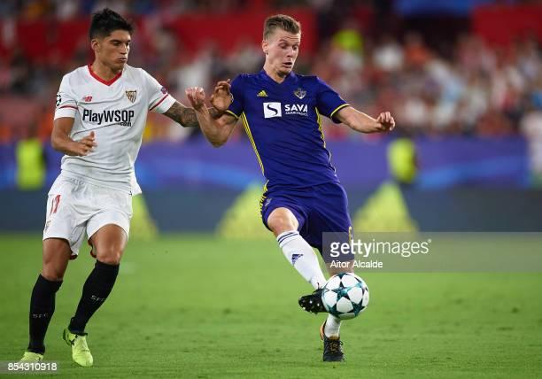 Aleks Pihler of NK Maribor competes with Joaquin Correa of Sevilla FC during the UEFA Champions League match between Sevilla FC and NK Maribor at...