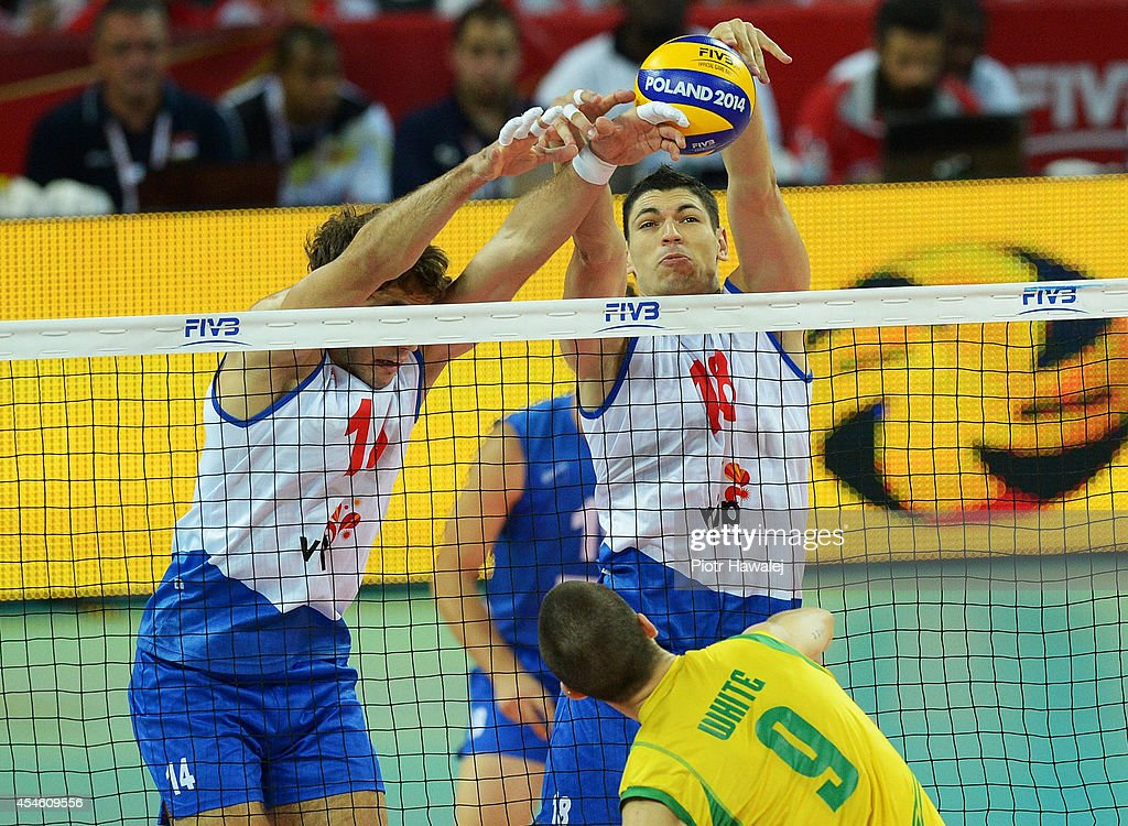 Aleksandar Atanasijevic and Marko Podrascanin of Serbia block the ball during the FIVB World Championships match between Serbia and Australia on...