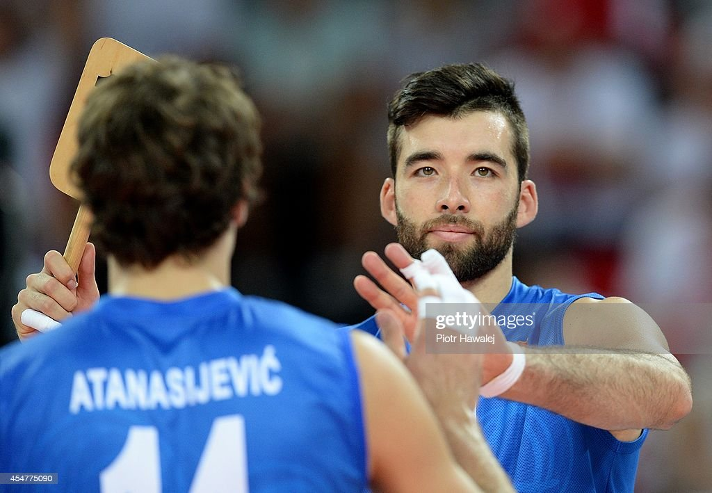 Aleksandar Atanasijevic of Serbia is substituted by Sasa Starovic during the FIVB World Championships match between Venezuela and Serbia on September 6, 2014 in Wroclaw, Poland.