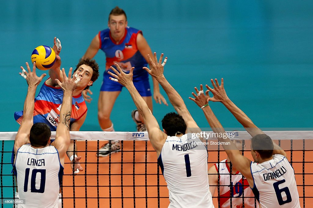 Aleksandar Atanasijevic of Serbia spikes the ball against Filipo Lanza of Italy during the FIVB World League Group 1 Finals match between Serbia and Italy at Maracanazinho Gymnasium on July 15, 2015 in Rio de Janeiro, Brazil.