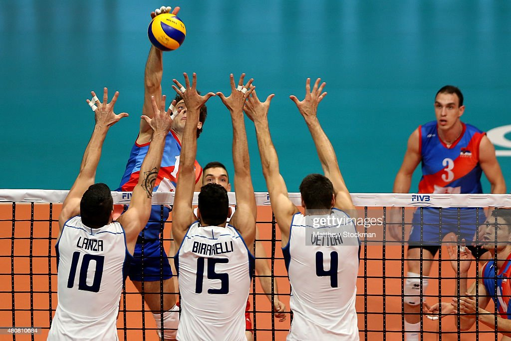 Aleksandar Atanasijevic of Serbia spikes the ball against (L-R) Filipo Lanza, <a gi-track='captionPersonalityLinkClicked' href=/galleries/search?phrase=Emanuele+Birarelli&family=editorial&specificpeople=5377918 ng-click='$event.stopPropagation()'>Emanuele Birarelli</a> and Luca Vettori of Italy during the FIVB World League Group 1 Finals match between Serbia and Italy at Maracanazinho Gymnasium on July 15, 2015 in Rio de Janeiro, Brazil.
