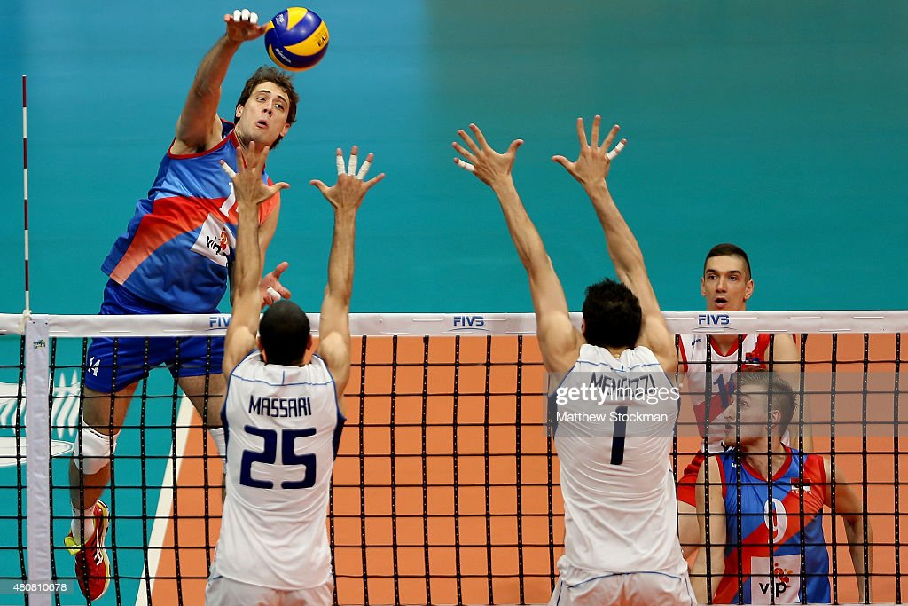 Aleksandar Atanasijevic of Serbia spikes the ball against (L-R) Jacopo Massari and Stefano Mengozzi of Italy during the FIVB World League Group 1 Finals match between Serbia and Italy at Maracanazinho Gymnasium on July 15, 2015 in Rio de Janeiro, Brazil.