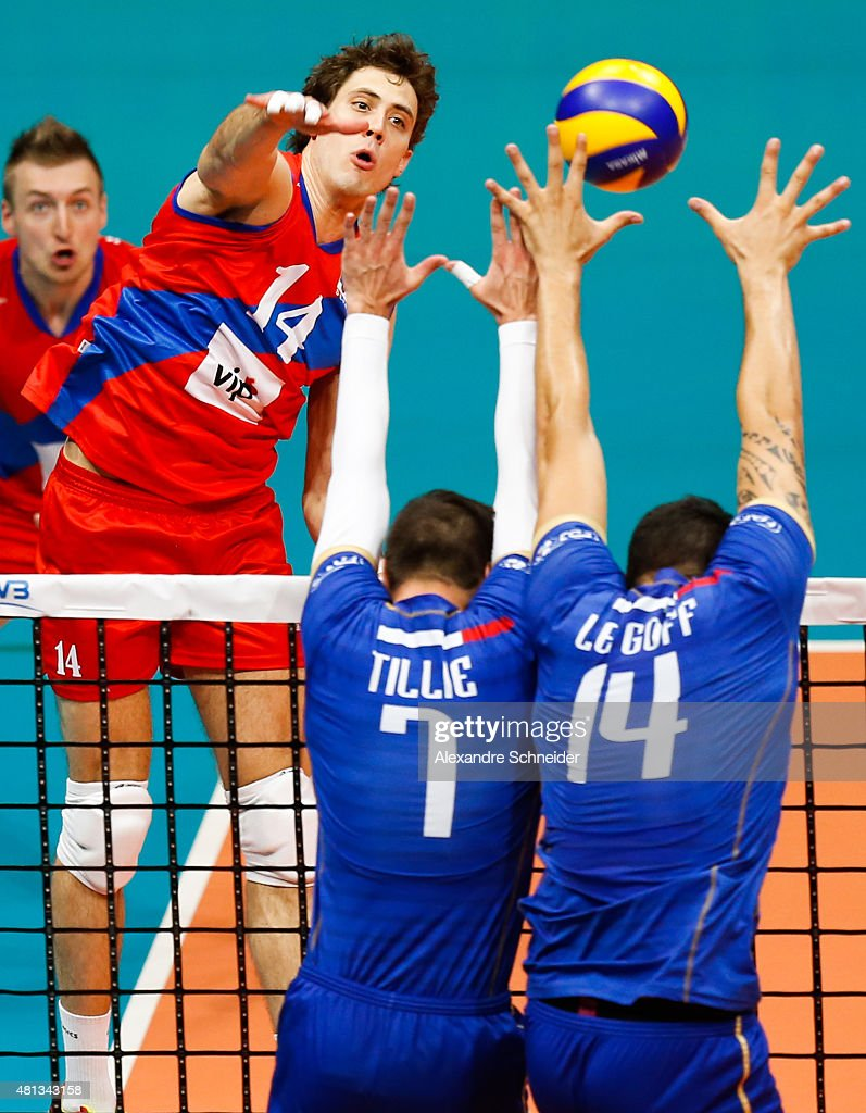 Aleksandar Atanasijevic of Serbia spikes the ball against Kevin Tillie #7 and Nicolas le Goff #14 of France during the FIVB World League Group 1 Finals first place match between France and Serbia at Maracanazinho Gymnasium during day five of the FIVB World League 2015 - Group 1 Final, on July 19, 2015 in Rio de Janeiro, Brazil.