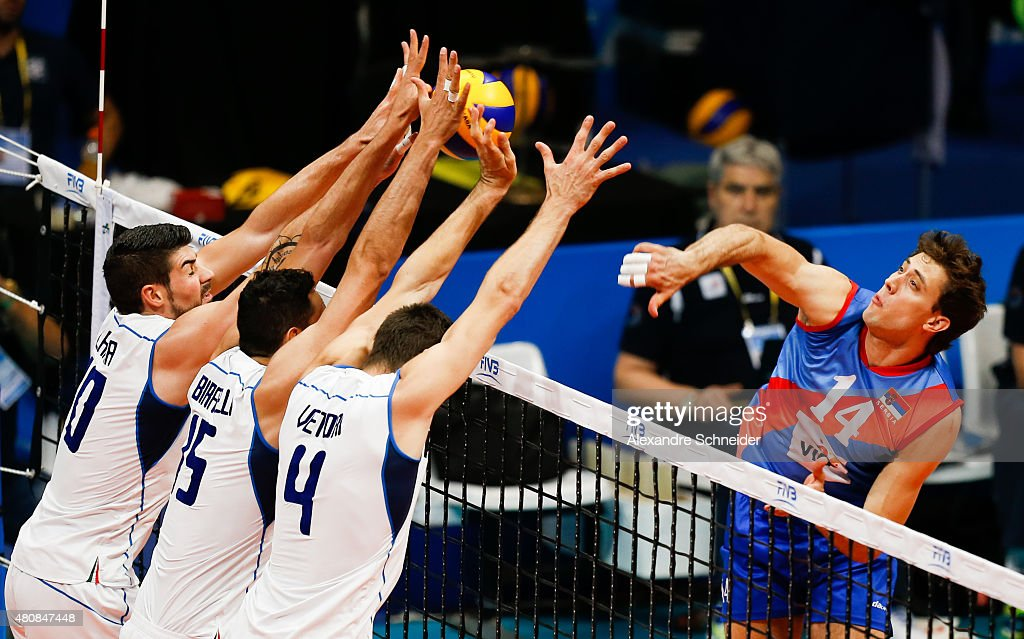 Aleksandar Atanasijevic of Serbia spikes the ball against Simone Gianelli #6 of Italy during the match between Sebia and Italy at Maracanazinho Gymnasium during day one of the FIVB World League 2015 Group 1 Final, on July 15, 2015 in Rio de Janeiro, Brazil.