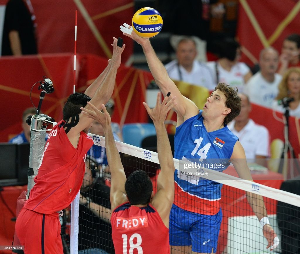 Aleksandar Atanasijevic of Serbia spikes the ball during the FIVB World Championships match between Venezuela and Serbia on September 6, 2014 in Wroclaw, Poland.