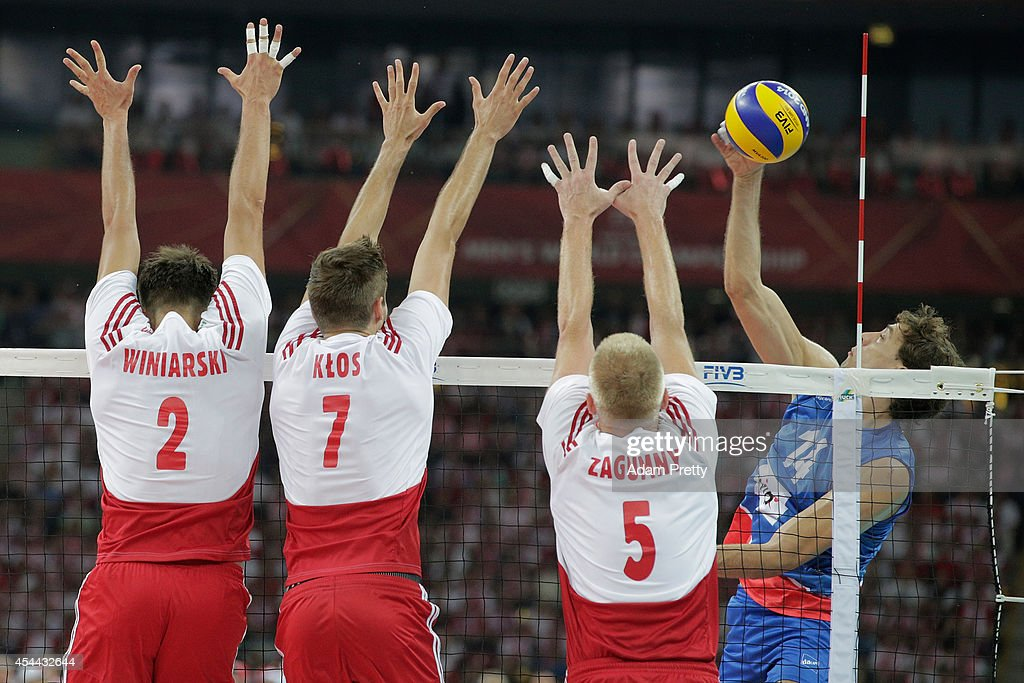 Aleksandar Atanasijevic (R) of Serbia strikes against Poland during the FIVB World Championships match between Poland and Serbia on August 30, 2014 in Warsaw, Poland.