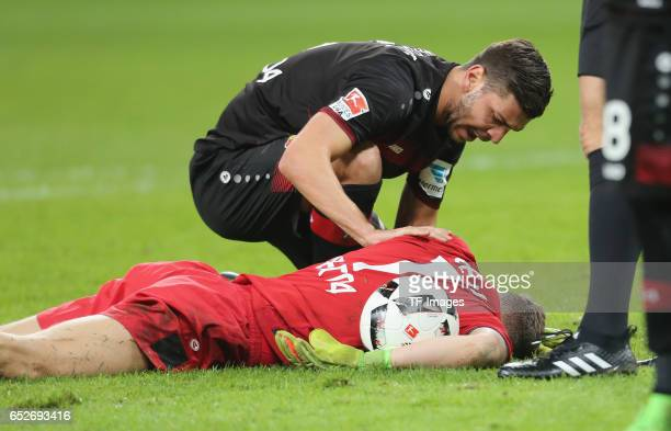 Aleksandar Dragovic and Goalkeeper Bernd Leno of Leverkusen injured during the Bundesliga soccer match between Bayer Leverkusen and Werder Bremen at...