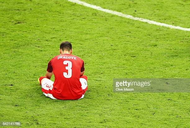 Aleksandar Dragovic of Austria is dejected after defeat in the UEFA EURO 2016 Group F match between Iceland and Austria at Stade de France on June 22...