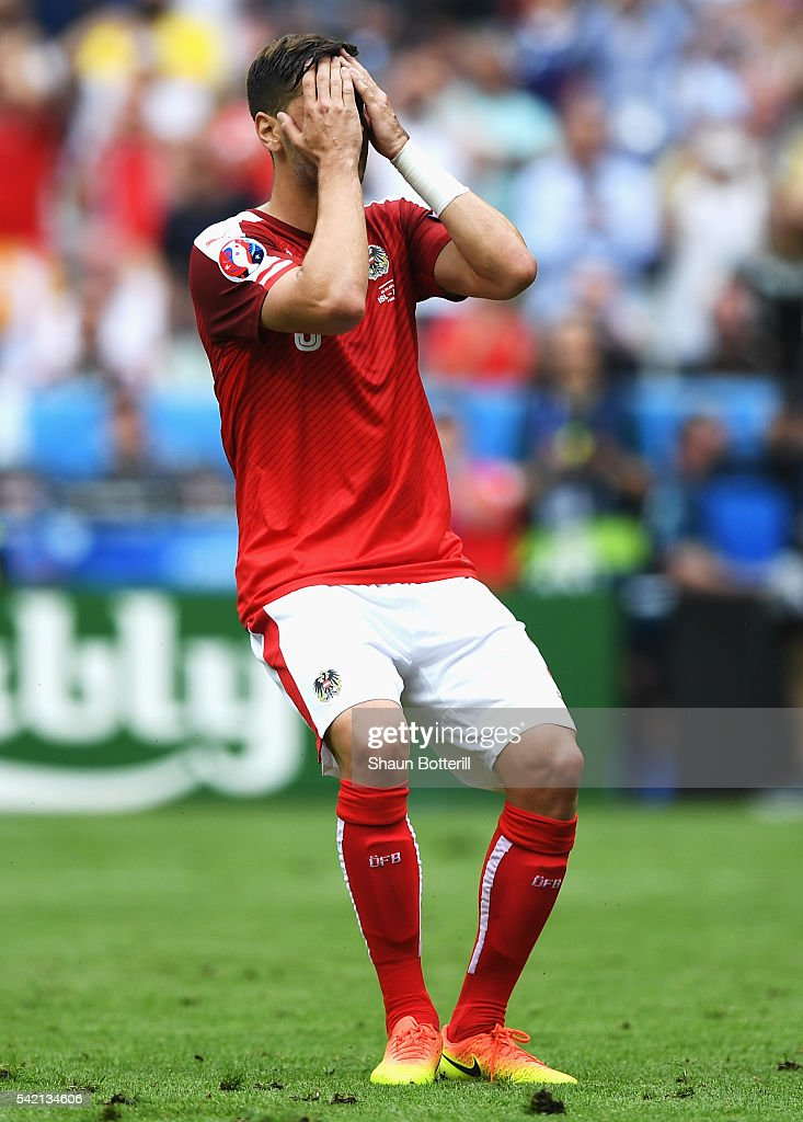 Aleksandar Dragovic of Austria sits with his head in his hands after missing a penalty during the UEFA EURO 2016 Group F match between Iceland and Austria at Stade de France on June 22, 2016 in Paris, France.