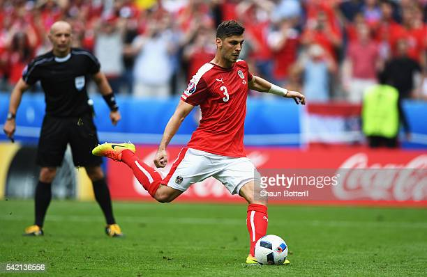 Aleksandar Dragovic of Austria strikes a penalty against the post during the UEFA EURO 2016 Group F match between Iceland and Austria at Stade de...