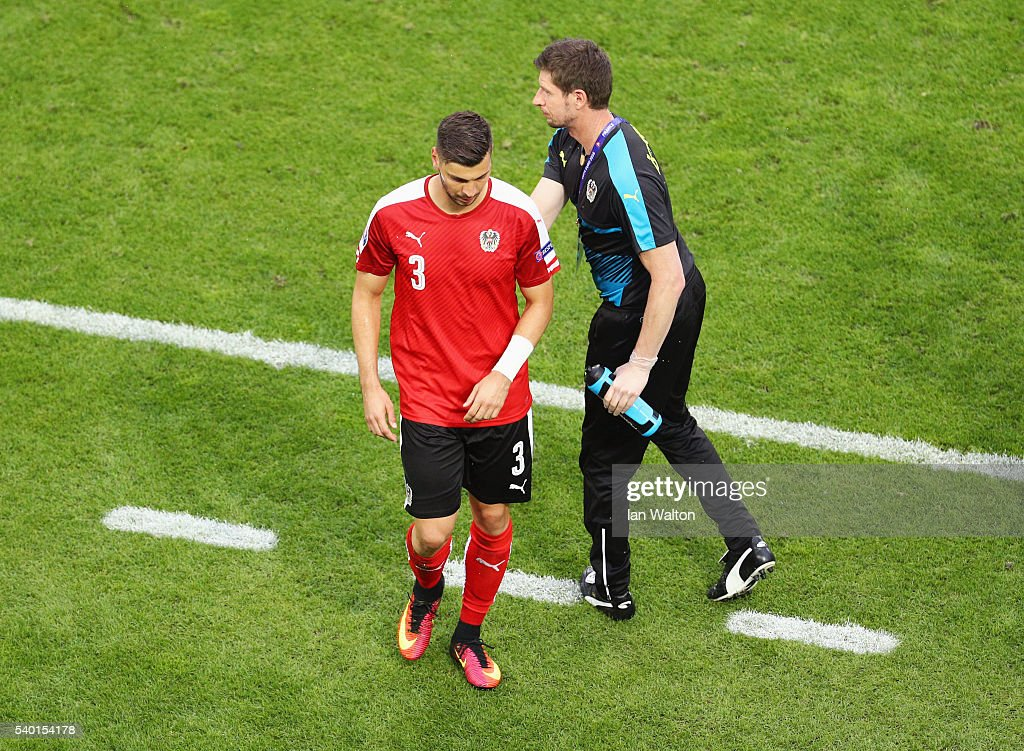 Aleksandar Dragovic of Austria walks off the pitch after sent off during the UEFA EURO 2016 Group F match between Austria and Hungary at Stade Matmut Atlantique on June 14, 2016 in Bordeaux, France.