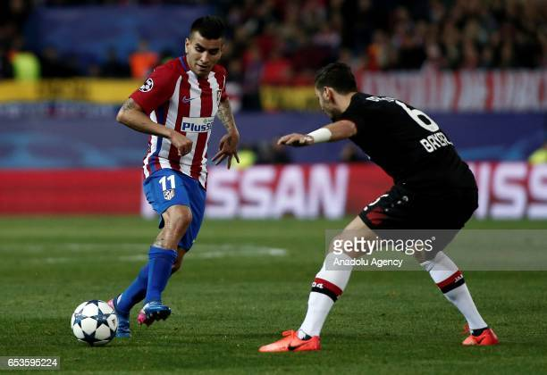 Aleksandar Dragovic of Bayer 04 Leverkusen in action against Angel Correa of Atletico Madrid during the UEFA Champions League Round of 16 football...