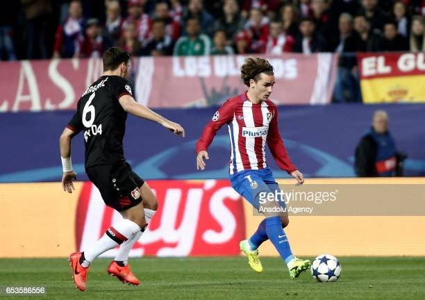 Aleksandar Dragovic of Bayer 04 Leverkusen in action against Antoine Griezmann of Atletico Madrid during the UEFA Champions League Round of 16...