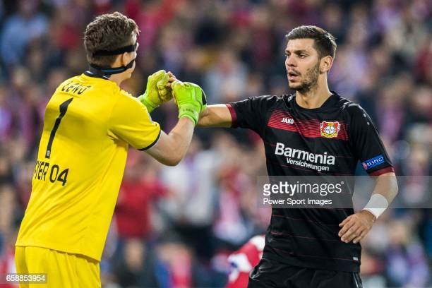 Aleksandar Dragovic of Bayer 04 Leverkusen talks with goalkeeper Bernd Leno of Bayer 04 Leverkusen during their 201617 UEFA Champions League Round of...