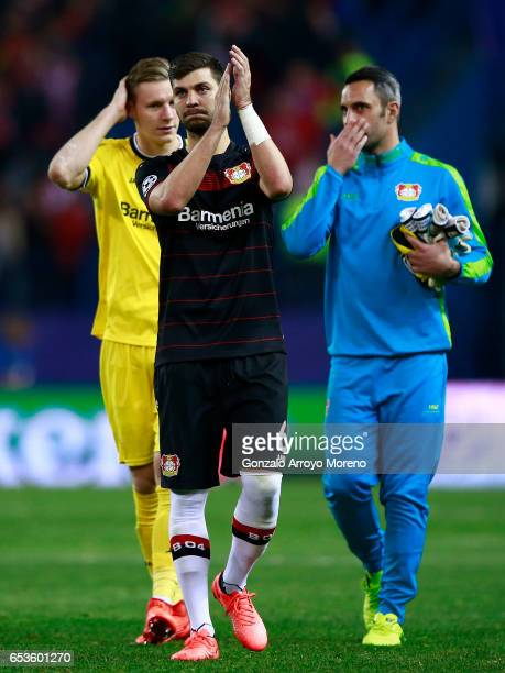 Aleksandar Dragovic of Bayer Leverkusen and his teammate goalkeeper Bernd Leno acknowledge the audience their fans after the UEFA Champions League...