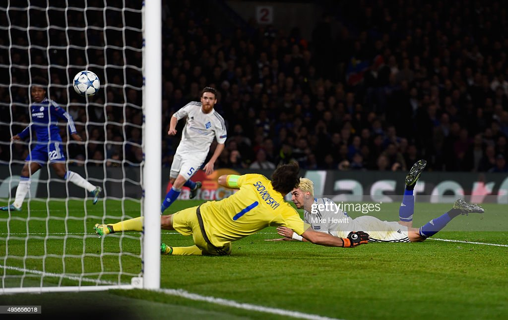 Aleksandar Dragovic (ground) of Dynamo Kyiv scores an own goal to open the scoring during the UEFA Champions League Group G match between Chelsea FC and FC Dynamo Kyiv at Stamford Bridge on November 4, 2015 in London, United Kingdom.