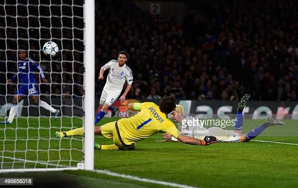 Aleksandar Dragovic of Dynamo Kyiv scores an own goal to open the scoring during the UEFA Champions League Group G match between Chelsea FC and FC...