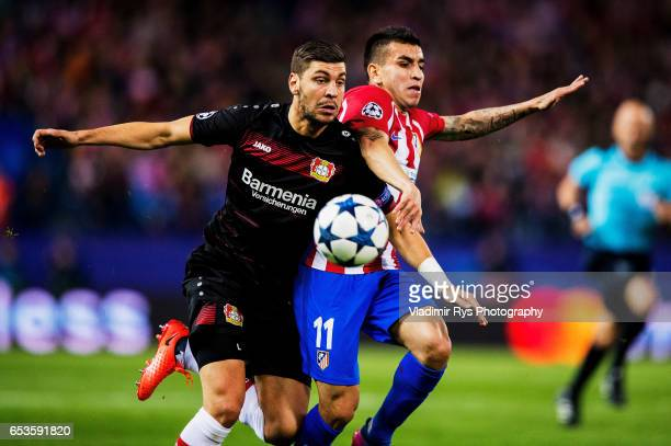 Aleksandar Dragovic of Leverkusen and Angel Correa of Atletico battle for the ball during the UEFA Champions League Round of 16 second leg match...