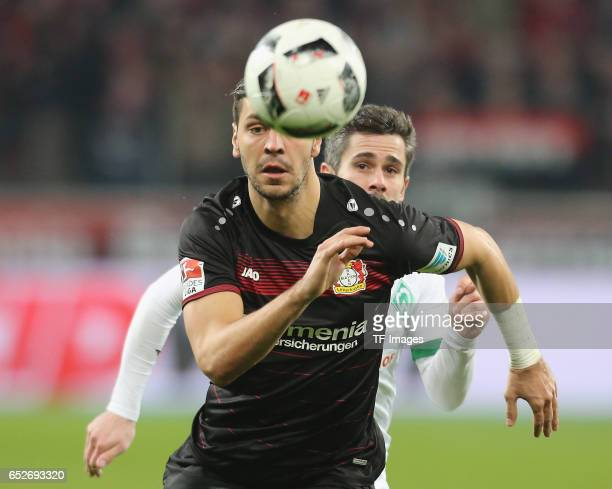 Aleksandar Dragovic of Leverkusen and Fin Bartels of Bremen controls the ball during the Bundesliga soccer match between Bayer Leverkusen and Werder...