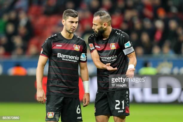 Aleksandar Dragovic of Leverkusen speak with Oemer Toprak of Leverkusen during the Bundesliga soccer match between Bayer Leverkusen and Werder Bremen...