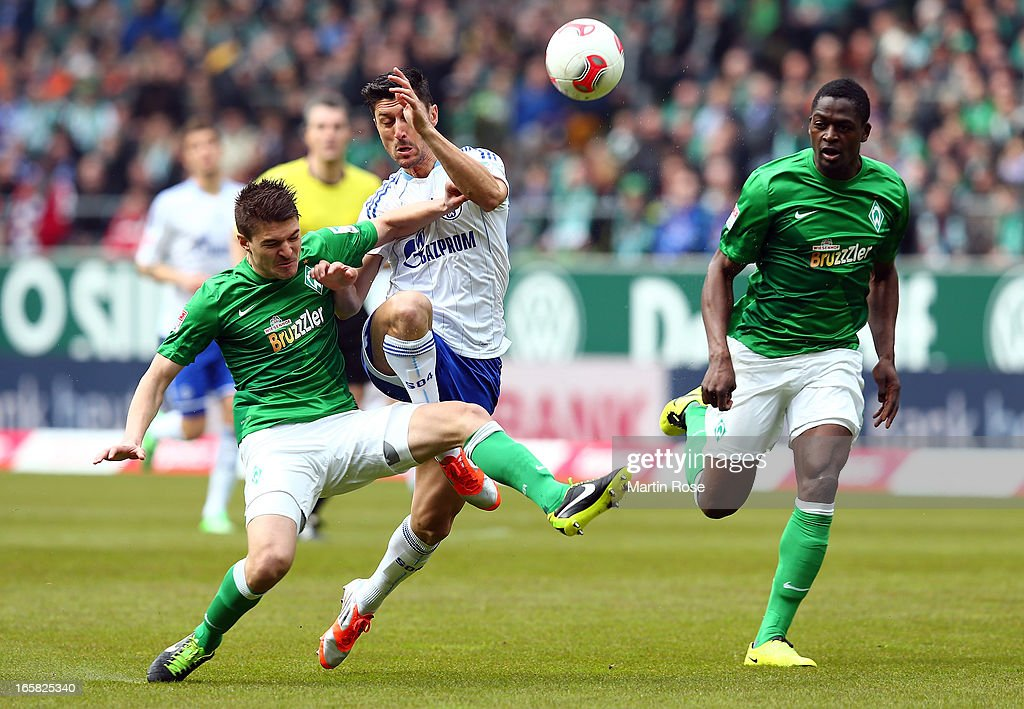 Aleksandar Ignjovski (L) of Bremen and Ciprian Marica (R) of Schalke battle for the ball during the Bundesliga match between Werder Bremen and FC Schalke 04 at Weser Stadium on April 6, 2013 in Bremen, Germany.