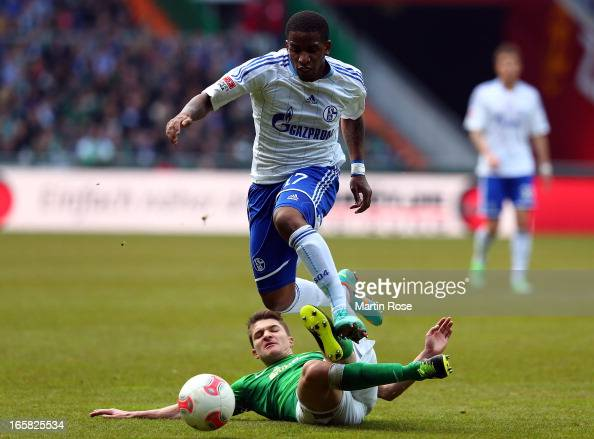 Aleksandar Ignjovski of Bremen and Jefferson Farfan of Schalke battle for the ball during the Bundesliga match between Werder Bremen and FC Schalke...