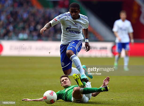 Aleksandar Ignjovski of Bremen and Jefferson Farfan of Schalke battle for the ball during the Bundesliga match between Werder Bremen and FC Schalke...