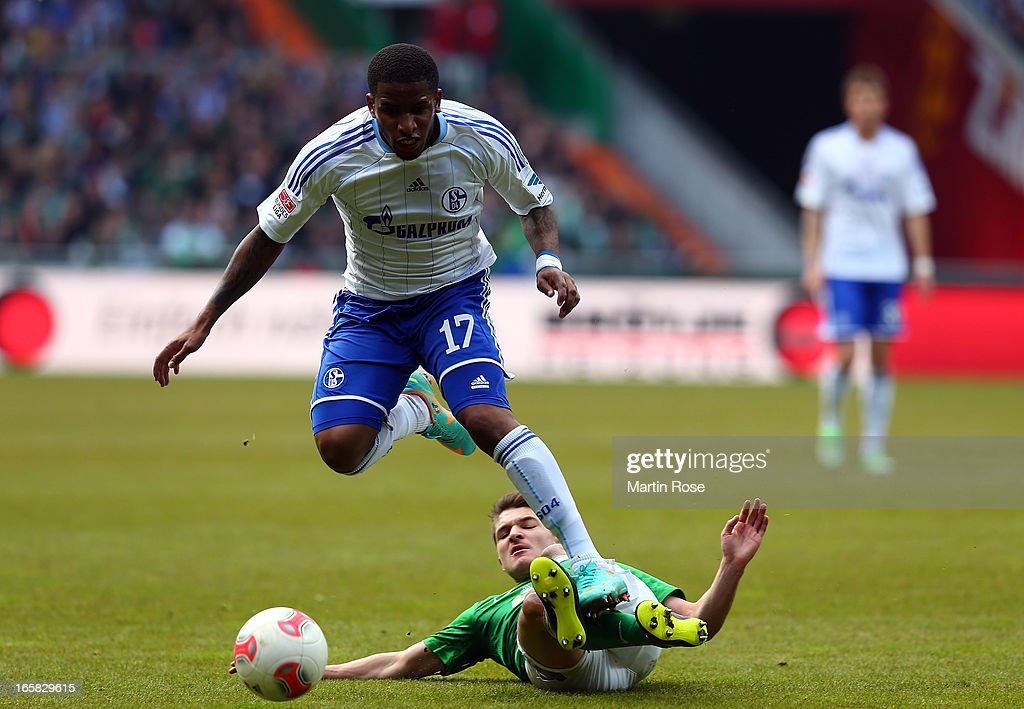 Aleksandar Ignjovski (back) of Bremen and Jefferson Farfan (front) of Schalke battle for the ball during the Bundesliga match between Werder Bremen and FC Schalke 04 at Weser Stadium on April 6, 2013 in Bremen, Germany.
