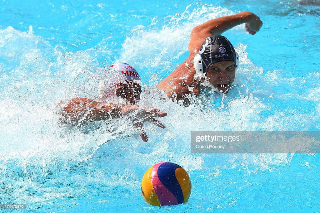 Aleksandar Ivovic of Montenegroin action againt against Stefan Curry (R) of New Zealand during the Men's Water Polo preliminary round match between Montenegro and New Zealand on day seven of the 15th FINA World Championships at the Piscina Bernat Picornell on July 26, 2013 in Barcelona, Spain.