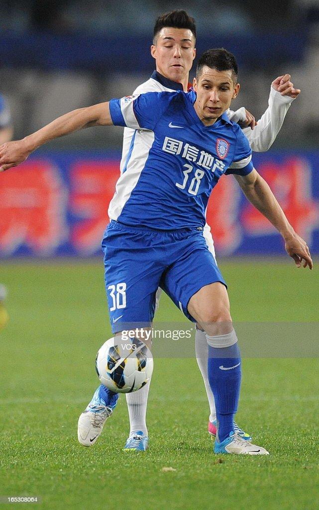 Aleksandar Jevtic #38 of Jiangsu Sainty eyes the ball during the AFC Champions League match between Jiangsu Sainty and Buriram United at Nanjing Olympic Sports Center Stadium on April 2, 2013 in Nanjing, China.