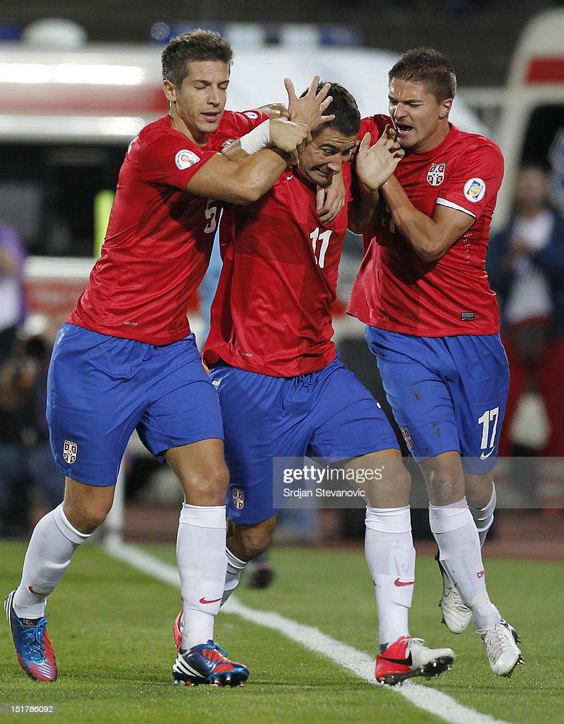 Aleksandar Kolarov (C) celebrates the goal with team-mates Matija Nastasic (L) and Aleksandar Ignjovski (R) of Serbia during the FIFA 2014 World Cup Qualifier at stadium Karadjordje Park between Serbia and Wales on September 11, 2012 in Novi Sad, Serbia