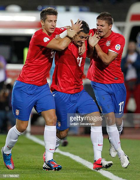 Aleksandar Kolarov celebrates the goal with teammates Matija Nastasic and Aleksandar Ignjovski of Serbia during the FIFA 2014 World Cup Qualifier at...