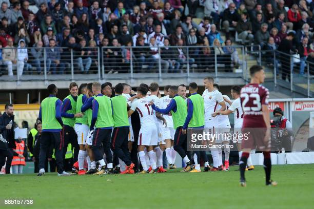 Aleksandar Kolarov celebrates with his teammates after scoring his goal during the Serie A football match between Torino Fc and As Roma As Roma wins...
