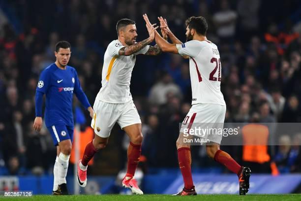 Aleksandar Kolarov of AS Roma celebrates scoring his sides first goal with Federico Fazio of AS Roma during the UEFA Champions League group C match...