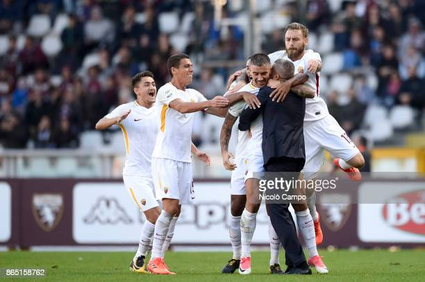 Aleksandar Kolarov of AS Roma celebrates with his teammates after scoring the winning goal during the Serie A football match between Torino FC and AS...