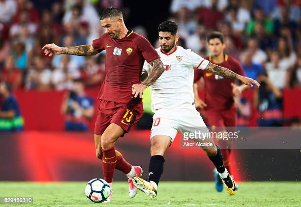 Aleksandar Kolarov of AS Roma competes for the ball with Ever Banega of Sevilla FC during a Pre Season Friendly match between Sevilla FC and AS Roma...