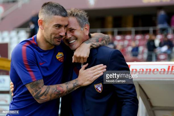 Aleksandar Kolarov of AS Roma hugs Sinisa Mihajlovic of Torino FC prior to the Serie A football match between Torino FC and AS Roma AS Roma won 10...