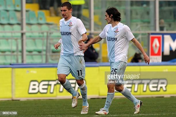 Aleksandar Kolarov of Lazio celebrates a goal with his team mate Giuseppe Biava during the Serie A match between US Citta di Palermo and SS Lazio at...