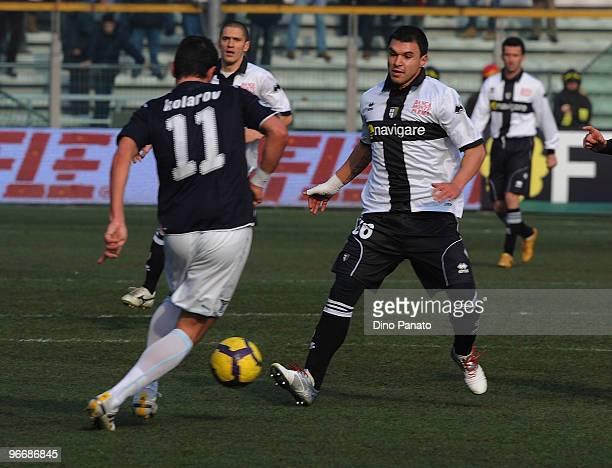 Aleksandar Kolarov of Lazio competes with Valeri Bojinov of Parma during the Serie A match between Parma FC and SS Lazio at Stadio Ennio Tardini on...