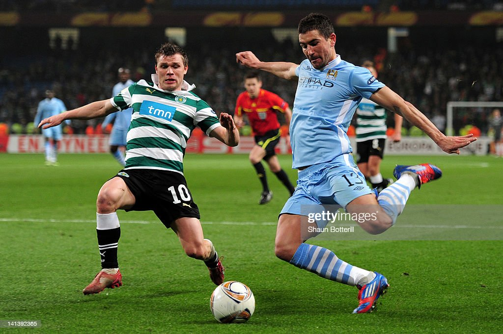 <a gi-track='captionPersonalityLinkClicked' href=/galleries/search?phrase=Aleksandar+Kolarov&family=editorial&specificpeople=4329824 ng-click='$event.stopPropagation()'>Aleksandar Kolarov</a> of Man City and <a gi-track='captionPersonalityLinkClicked' href=/galleries/search?phrase=Marat+Izmailov&family=editorial&specificpeople=2174070 ng-click='$event.stopPropagation()'>Marat Izmailov</a> of Sporting Lisbon battle for the ball during the UEFA Europa League round of 16 second leg match between Manchester City FC and Sporting Lisbon at Etihad Stadium on March 15, 2012 in Manchester, England.