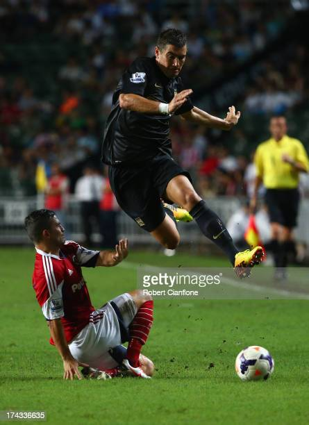 Aleksandar Kolarov of Mancester City leaps over his opponent during the Barclays Asia Trophy Semi Final match between Manchester City and South China...