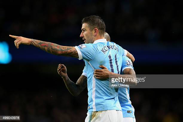 Aleksandar Kolarov of Manchester City celebrates scoring his team's third goal during the Barclays Premier League match between Manchester City and...