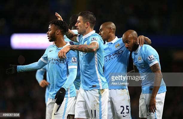 Aleksandar Kolarov of Manchester City celebrates scoring his team's third goal with his team mates during the Barclays Premier League match between...
